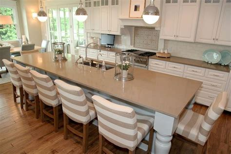 transitional kitchen by dwellings the large island seats 7 kitchen