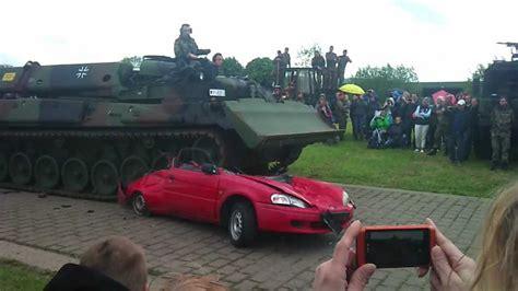 Auto Tanken by Tank Vs Car
