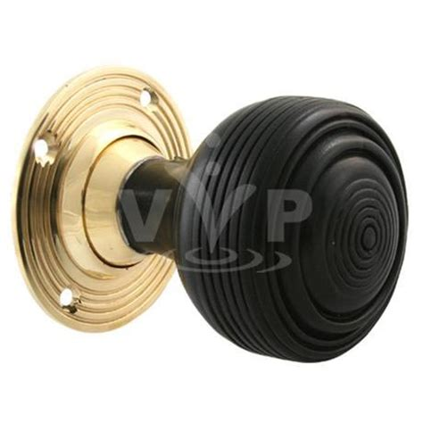classic wooden beehive door knobs with brass back plate at