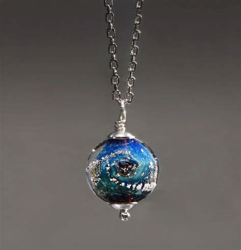 ashes jewelry custom glass planets containing the cremated remains of loved ones colossal