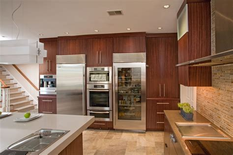 kitchen with sub zero refrigerators and miele ovens