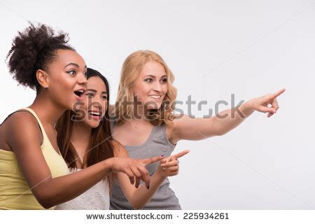 women laughing and pointing at sissy men wearing dresses girl laughing pointing stock images royalty free images