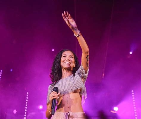 jhene aiko tattoos jhene aiko gets of big s on arm
