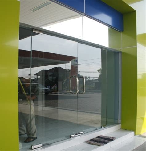 Pintu Sliding Kaca Di Tangerang pintu kaca tempered frameless di manado distributor of