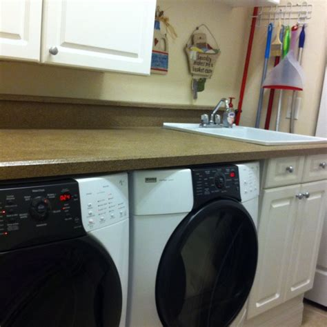 How To Install Cabinets In Laundry Room Laundry Room Makeover Installing Countertop Washer Dryer And Cabinets In Laundry Room