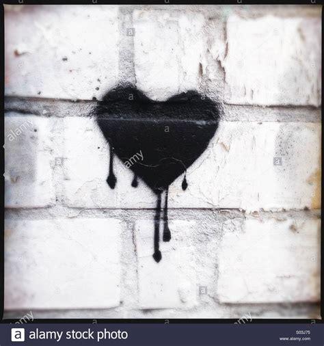 bleeding black heart stencil graffiti stock photo royalty