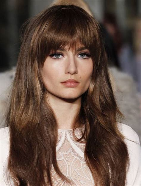 styling heavy bangs mid length hair with bangs a classic it girl style