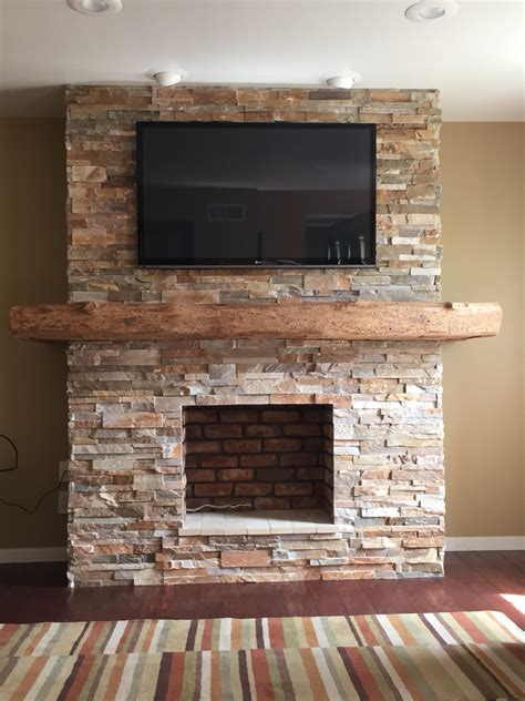 fireplace with wrap around barn beam mantel house