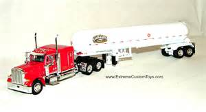 64 scale trucks this 1 64 scale combination features a red peterbilt