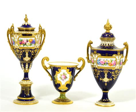 Urn Shaped Planters by Tennants Auctioneers A Royal Crown Derby Urn Shaped Handled Vase And Cover