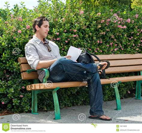 bench reading reading on park bench stock photo image 10074620