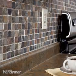 how to install a mosaic tile backsplash in the kitchen how to tile a backsplash the family handyman