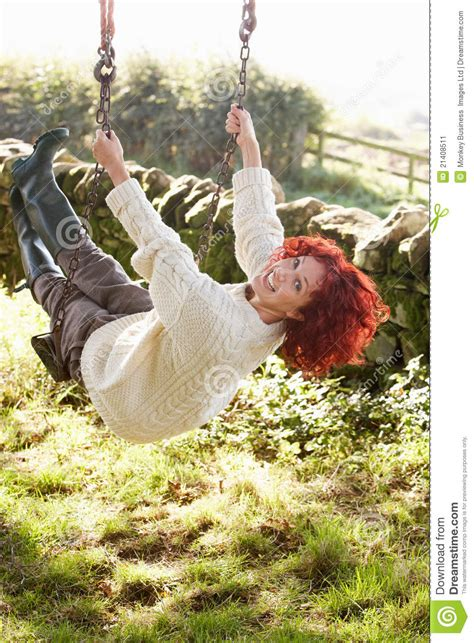 swinging country woman on country garden swing stock image image 21408511