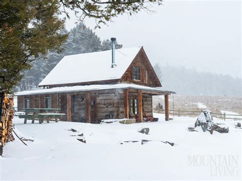 snowy cabin exterior snow pine trees chimney log