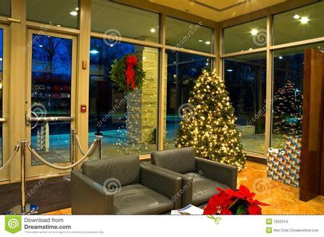 christmas tree in office lobby 2 stock photo image