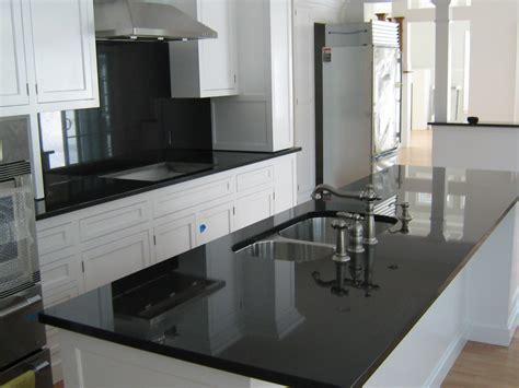 Kitchen With Black Countertops And White Cabinets Absolute Black Granite Installed Design Photos And Reviews Granix Inc