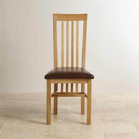 solid oak high slat back and brown leather dining chair