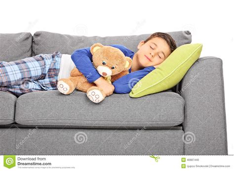 napping couch little boy taking a nap on a couch stock photo image