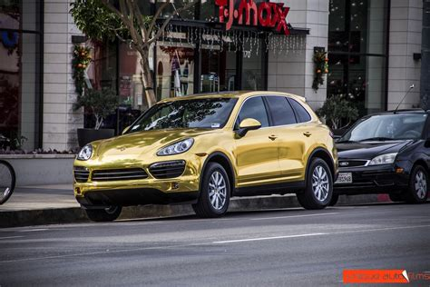 chrome porsche project 24k gold porsche cayenne gold chrome vinyl wrap
