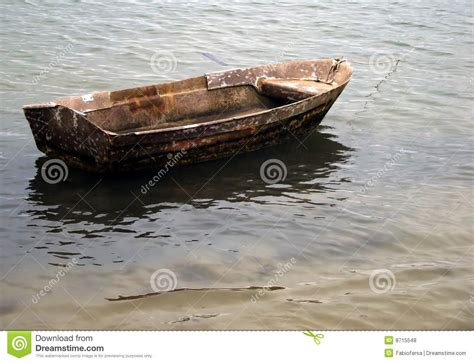small wooden boat small wooden boat anchored on the beach royalty free stock