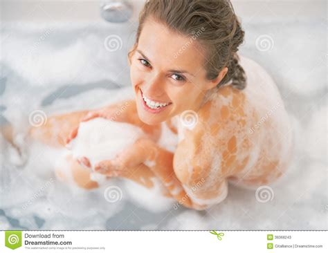 how to make foam in bathtub smiling young woman playing with foam in bathtub stock