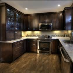 Dark Cabinet Kitchen by Cherry Cabinets With A Mocha Finish Kashmir White Granite