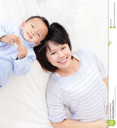 mom son bed mother and son in bed royalty free stock photography