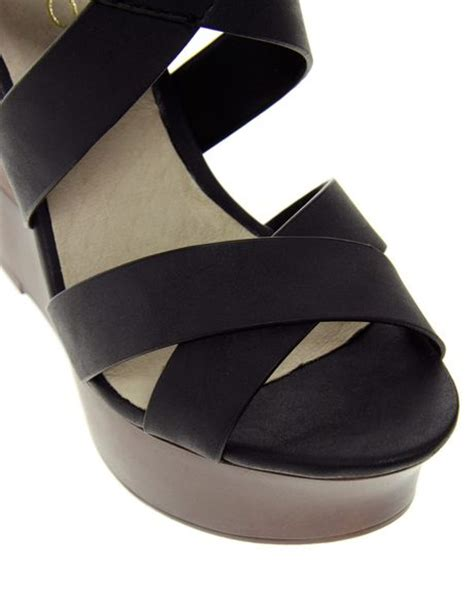 Punched Cut Out Platform Wedges At Asos by Aldo Wolfeda Platform Cut Out Wedges In Black Lyst