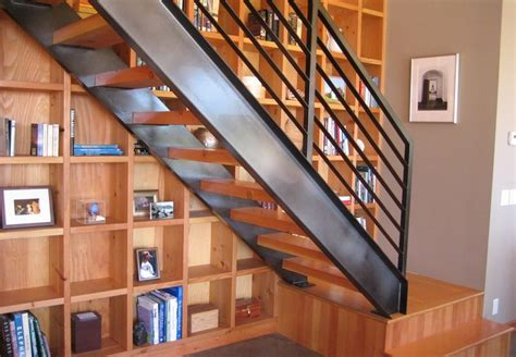 Floor To Ceiling Bookshelf Designs That Prove Staircases And Bookshelves Make A Great Duo