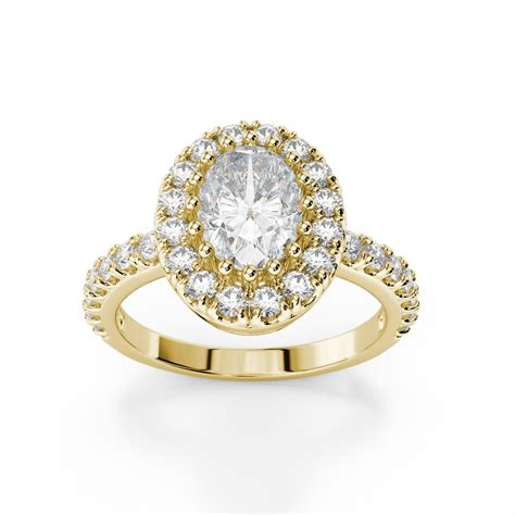 oval halo engagement ring with side stones 18kt