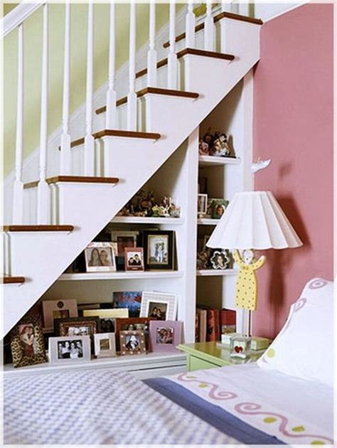 under stair shelving 27 genius ways to use the space under your stairs