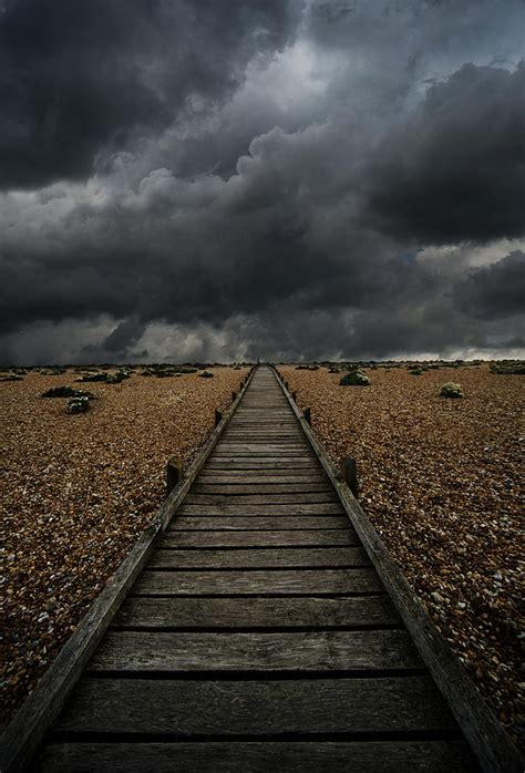 dramatic background wooden path in the wilderness dramatic sky in the