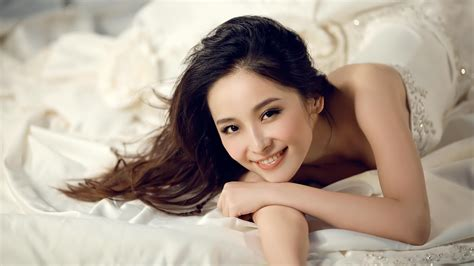 what are chinese women like in bed beautiful girl bed smiles asian girl white dress