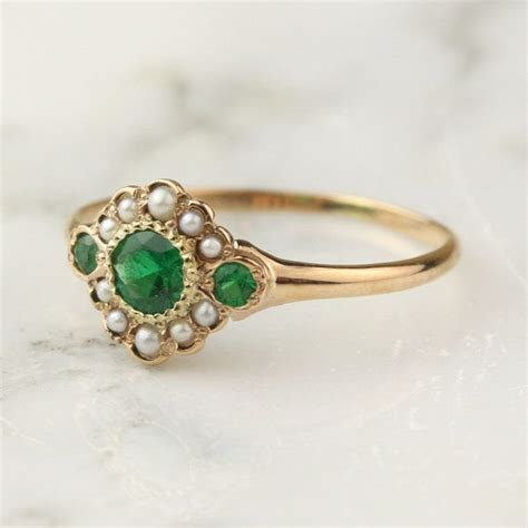 antique emerald pearl halo ring in 14k gold rings