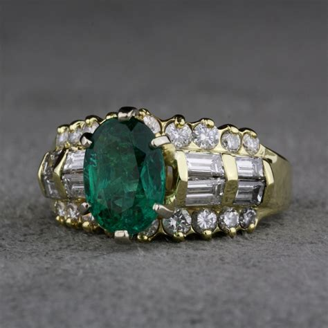 pre owned emerald and ring