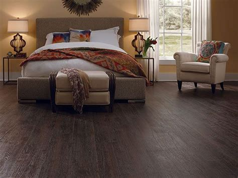 laminate flooring ideas bedroom dark laminate flooring creates a warm and comfort feel in this bedroom laminate
