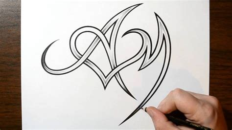 heart letter tattoo designs drawing letters a and m with a design