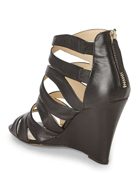nine west sandal wedges nine west black cronin caged wedge sandal in black lyst