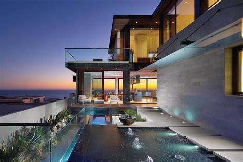 house with a beautiful view overlapping pools ocean view define coastal home