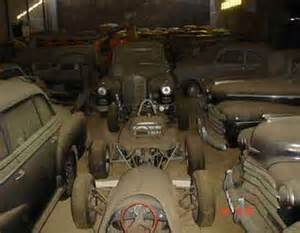 photos of car collection found in portugal barn