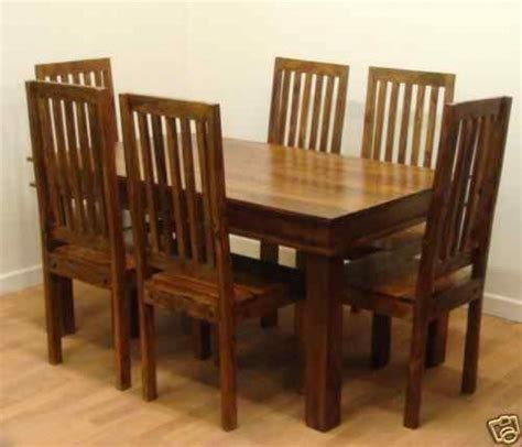 Solid Wood Table And Chairs by Go Solid Wood Dining Table And Chairs All Chairs Design