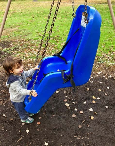 swing for child with disabilities love that max the big blue swing in the park