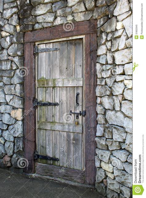 antique wooden door   stone wall stock image image