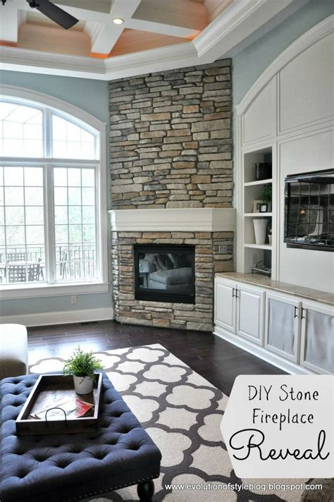stone with built ins fireplace in corner tv in built ins living room