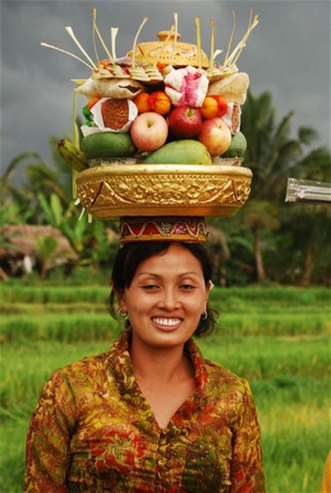 Woman With Fruit Basket On Head | woman holding a fruit basket on her head where there be