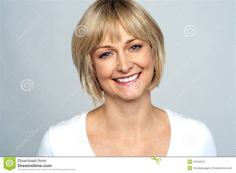 middle age hair cut in dreams portrait of a smiling middle aged caucasian woman stock