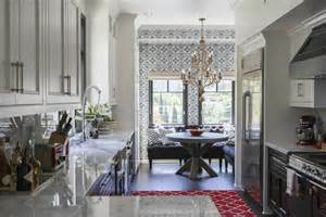 Kitchen rug white upper cabinets black lower cabinets and a bright
