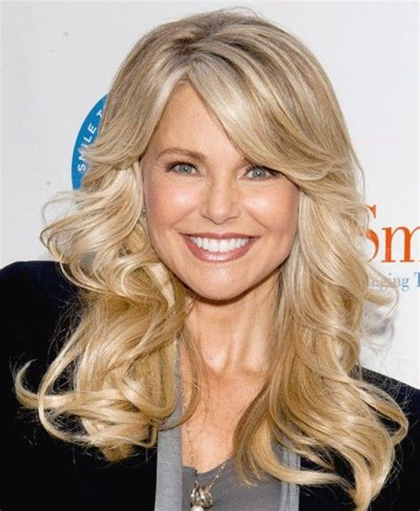 milf hairstyles 2014 over 50 fall hairstyle idea flicked back long blonde waves