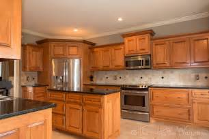kitchen golden oak cabinets with white appliances maple