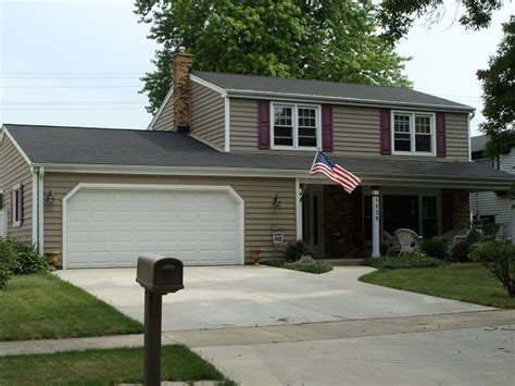 briarwood naperville prodigy 6 insulated siding color tuscan clay alside soffit fascia and